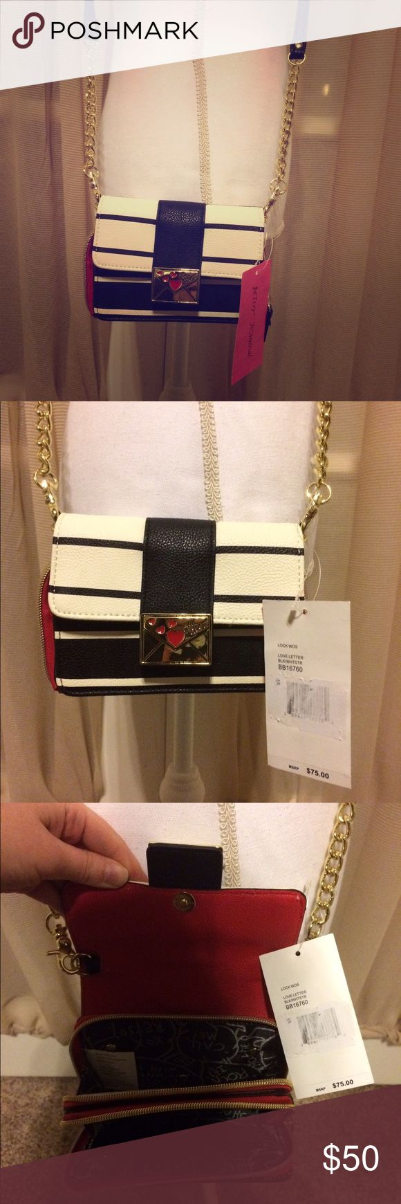 """🆕NWT Betsey Johnson crossbody love letter 💌 NWT Betsey Johnson mini cross body love letter purse. Has gold detachable strap with a strap drop of 24"""". Other measurements: 6 1/4"""" x 4"""" x 4"""". Purse has black & white stripes on the exterior & a red interior with Betsey's signature interior writing. 2 large open pockets on the inside & 3 small slots. Magnetic button closure with really cute gold love letter accent. Reasonable offers warmly welcomed 😊 Betsey Johnson Bags Mini Bags"""