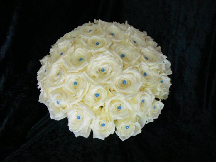 All white rose bouquet with blue tipped diamante pins in centres