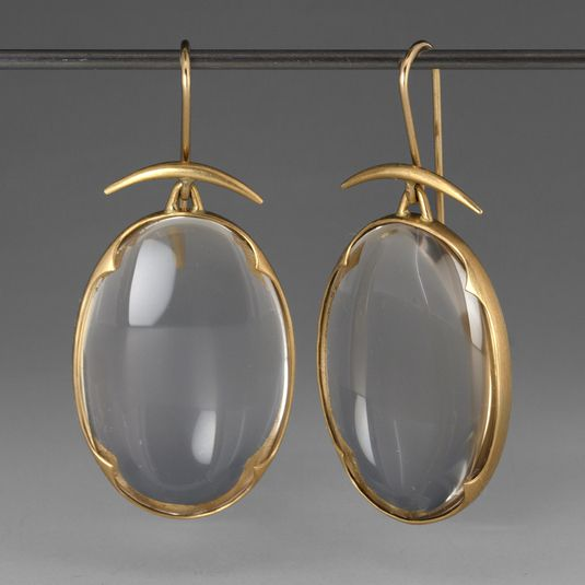 A pair of 18k yellow gold earrings with small quartz crystal lens' set in scalloped bezels hand made by Gabriella Kiss.