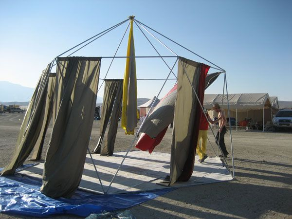 """Hexayurt made from metal conduit (30 pieces.)  Wall height 8'8"""", peak height 13'8"""".  300 sq ft."""