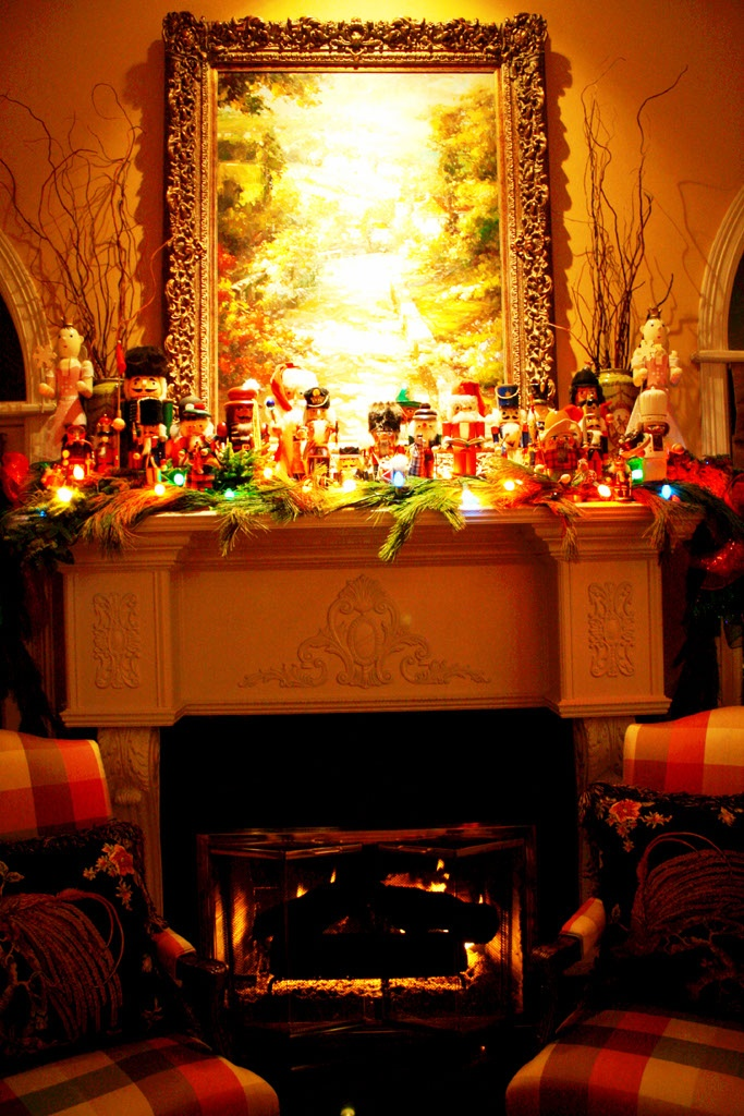 Nutcracker Collection On Mantle With Colored Lights And