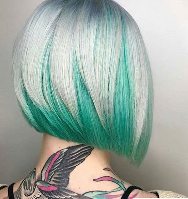 White geometric bob haircut with mint green under-colour