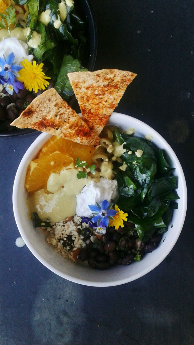 """Moroccan Cauliflower Rice Power Bowl with Lemon-Parsley Black Beans, Massaged Spinach, Spiced Tortilla Crisps and Sunflower Seed """"Melted Cheese"""""""