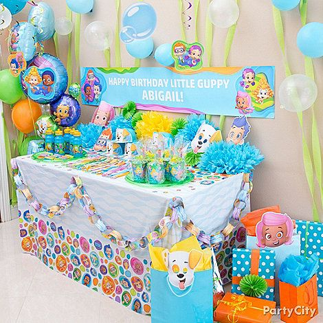 Set up a favor reef! Use balloons & streamers to imitate an underwater scene. Hang up a custom Bubble Guppies banner to tie it all together!