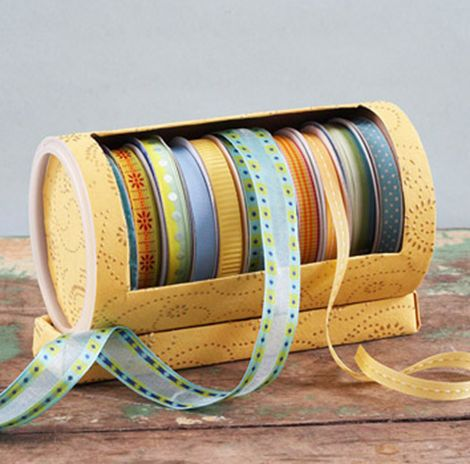 Store ribbons in a recycled oatmeal container. ...and several other ideas for organizing ribbon.