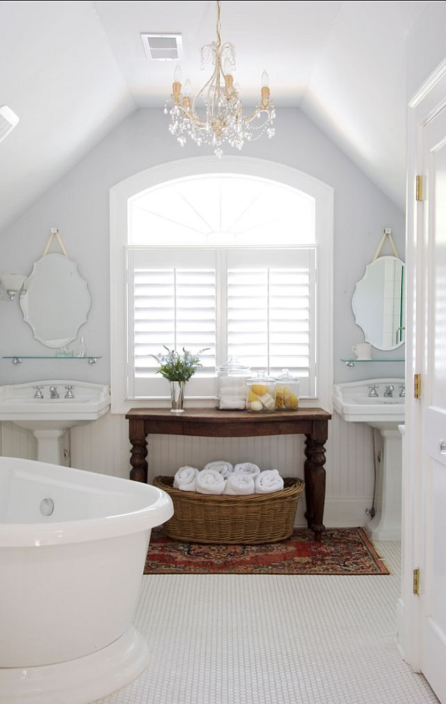 Bath elements:  bead board wainscot, pedestal sink, frameless mirror installed with a knob and rope, shutters, antique table in dark stain