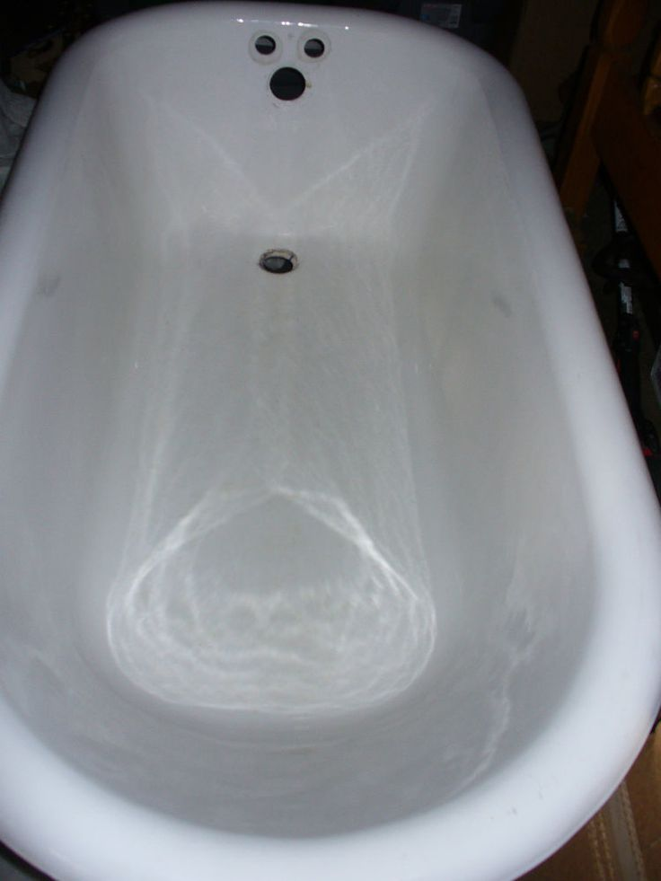 cast iron clawfoot tub and NEW Pedastal Sink ink included