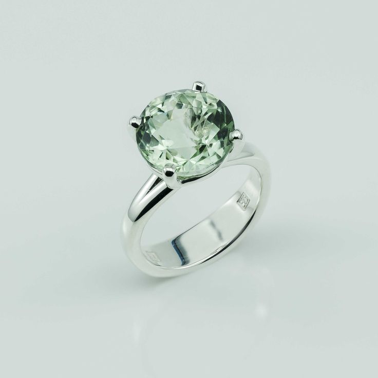 Our custom faceted 12mm round Green Amethyst features in an Argentium Silver claw set ring