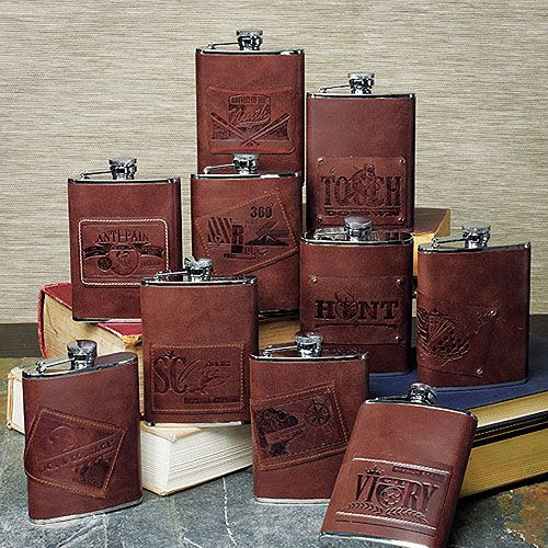 Hip flasks wrapped in luscious brown leather are an ideal gift for the man in your life. Choose from an assortment of designer personality patches for a gift that will truly reflect his style. Each flask holds 6 fluid oz. Available for purchase online at http://madelinesweddings.weddingstar.com/product/h2o-hip-to-own-stainless-flask