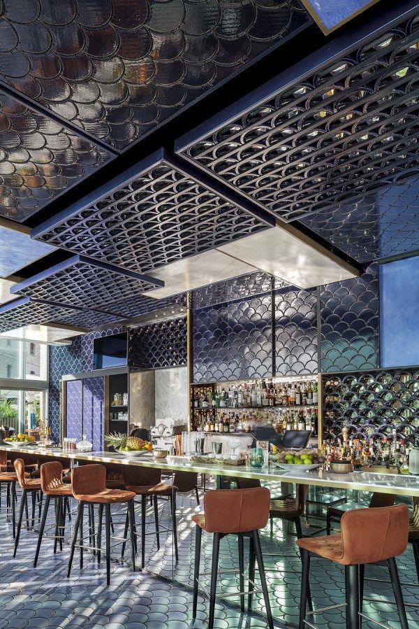 Tile of Spain Awards winnner - Blue Wave Cocktail bar. Photography by Adria Goula. A clever and beautiful use of tile in this coastal Barcelona bar is an interpretation of waves in every detail.