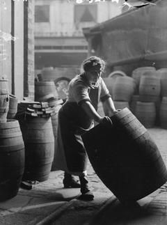 Woman working in the cooperage in a London brewery, c 1916