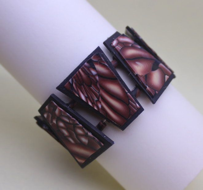 Braccialetto trapezi fantasia ali marrone. Brown wings bracelet.