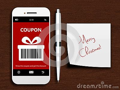 Mobile phone with christmas coupon, pen and christmas wishes lying on wooden desk