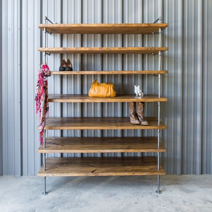 Closet shelving doesn't have to be boring. This shelving unit is really heavy duty and extra deep for shoe and purse storage. Now you have an excuse to buy more shoes. The shelf pictured is a custom h