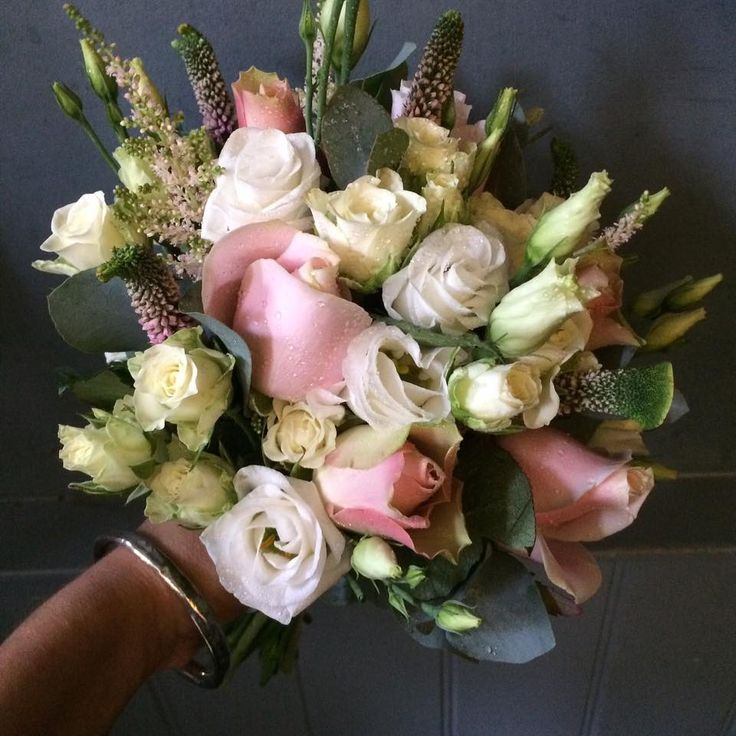 Rose buds and lisianthus with soft pink astilbe and veronica wedding bouquet.