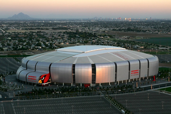 University of Phoenix Stadium - home of the Cardinals Pro-football team - Camelback Mountain (left) and downtown Phoenix (right) in background