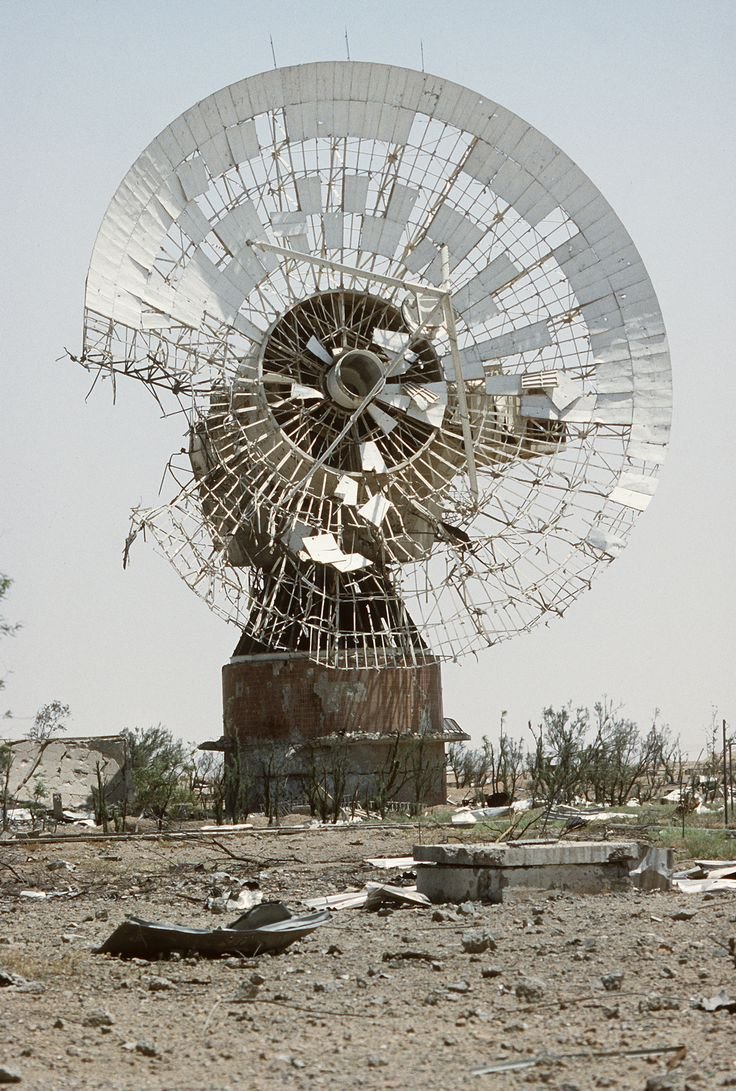 she-dreamt-she-was-a-bulldozer:A damaged satellite dish remains standing in the aftermath of Operation Desert Storm.
