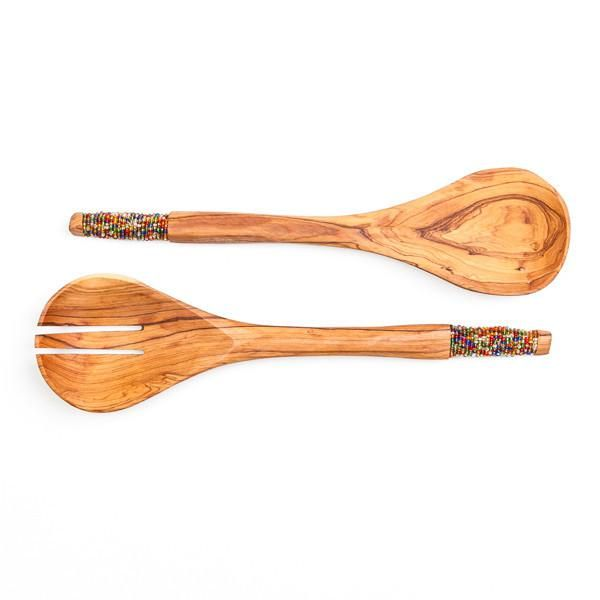 Hand carved African Olive Wood Salad Servers decorated with Maasai glass beads. Made out of one piece of wood, the oval shaped ladle is carefully carved into thin handles and decorated with a mix of dark coloured glass beads. An eye-catching accessory to any salad meal. ----- About the brand Love'edu: Lov'edu Living was founded by Ibiza raised Anna Boettcher in 2013 in London. Today, Lov'edu is both a physical and an online ethical store that offers unique interior decoration, accessories…