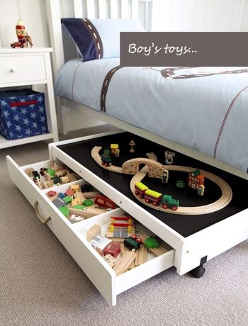 Which little boy wouldn't love a train set under his bed? Image by Great Little Trading Co #bedroom #interiordesign