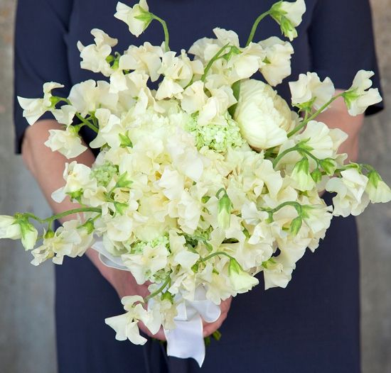 Paul Thomas hand tie bouquet design with white sweet peas at New Covent Garden Flower Market during British Flowers Week 2013