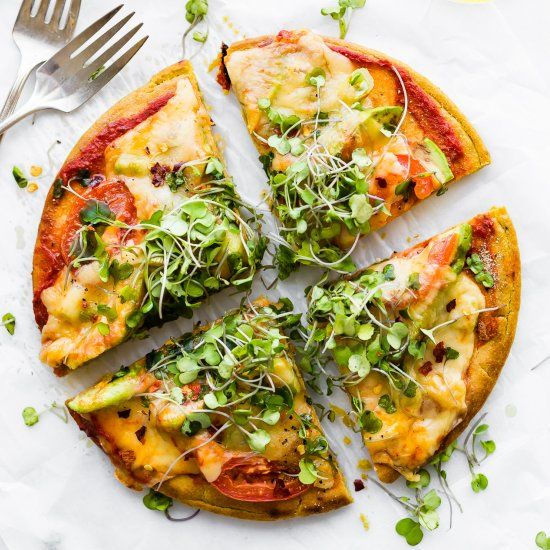 Avocado Tomato Gouda Socca Pizza! A grain free, gluten free Pizza made with chickpea flour and Avocado Gouda Melted goodness!