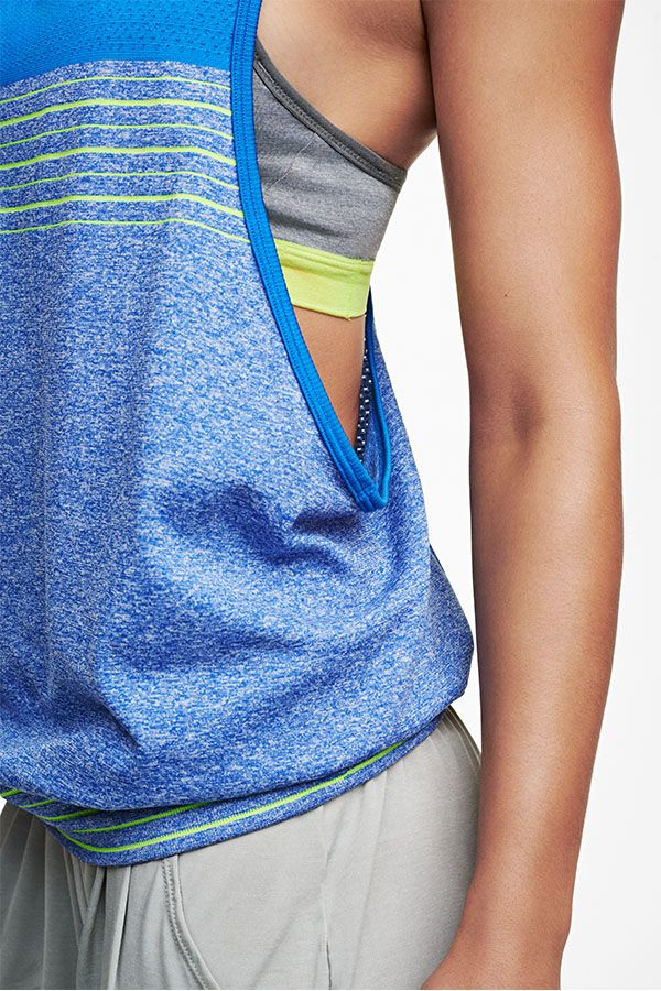 Balanced and breezy. The Nike Dri-FIT Knit Loose Tank is made with the perfect blend of materials to keep you dry and moving through every yoga pose.