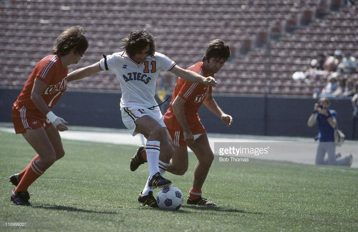 Northern Irish footballer George Best (1946 - 2005, centre) playing for the Los Angeles Aztecs against Dallas Tornado, USA, 1977.