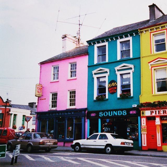 T R A V E L Some cultures love to celebrate colour! These 1880 shopfronts with elaborate decorative render add to the character and architectural heritage of 'The Square', Skibbereen, County Cork, Ireland // photo @karinaeastway
