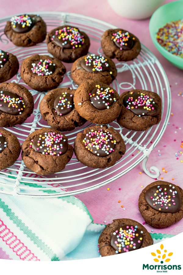 Thumbprint Biscuits  Ingredients  115g butter, softened 60g caster sugar 40g cocoa powder 200g self-raising flour 150g dark chocolate, break into chunks 100ml condensed milk 1 pack hundreds and thousands