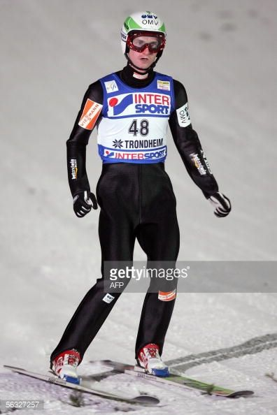 Picture taken 03 December 2005 shows Czech's Jakub Janda during the WC Ski Jumping event in Lillehammer central Norway Switzerland's Andreas Kuettel...