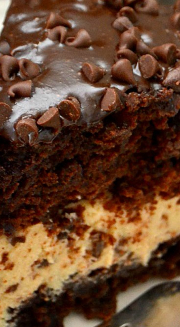 Chocolate Chip Cookie Dough Brownie Bomb Cake ~ So this cake is kinda sorta ridiculous in the best way possible... Two brownie layers sandwiched around chocolate chip cookie dough, and covered in chocolate ganache and chocolate chips.