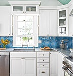 Colorful Key West Cottage Kitchen; white cabinets with glass blue tile backsplash