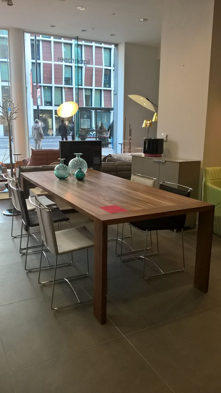 Eaton Solid walnut Dining table in a  hefty 240 x 100 size. It is usually £3722.00 but this table has had a couple of knocks and so we are knocking 40% off at £2500.00. See other pics for detail of the knocks