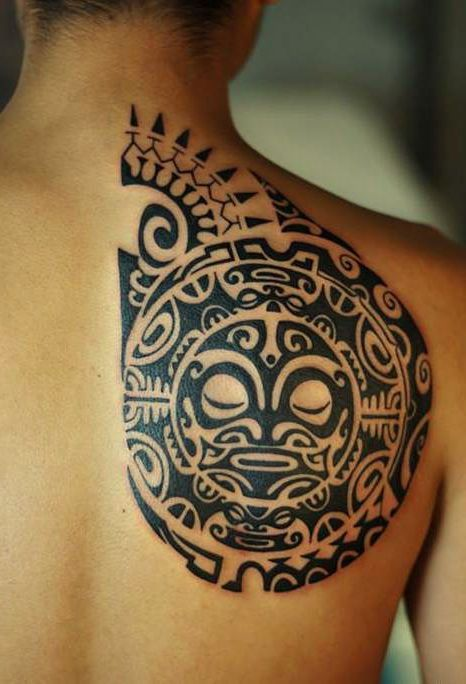 Polynesian Culture//I love the placement and the design, mostly the design because this tattoo has all of the elements of Polynesian Culture, it has the ocean, turtle shell, tiki head, Marquesan Cross, Enata, Spear heads, Fish/Shark teeth, lizard and the sun.