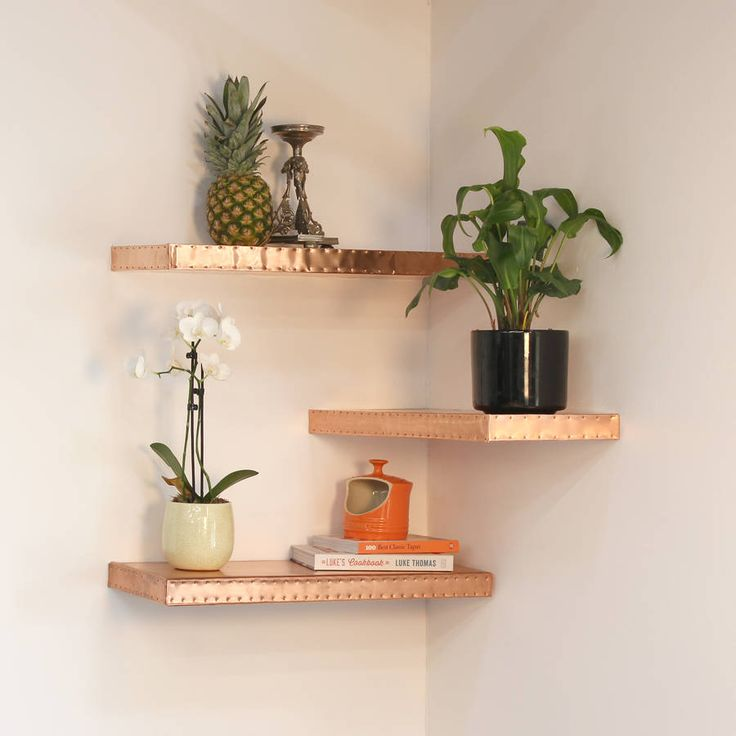 Metallic open shelves spruce up the dullest of walls! #CreativeOpenShelving