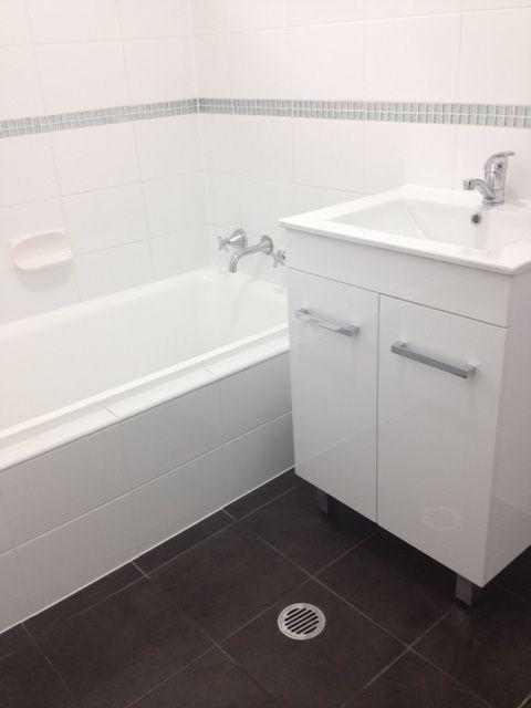 Floor: Renegade Black cushioned 300 x 300mm #832031 Wall: Dynasty White Gloss 300 x 200mm #500030 Feature Mosaic: GM-Paris 28 x 28mm