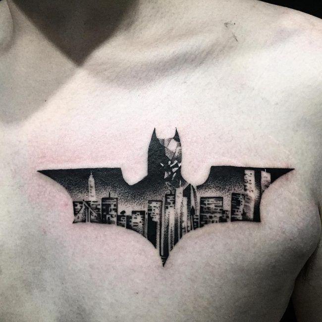 Batman symbol chest tattoo