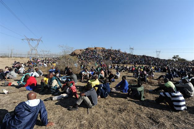 Marikana: A year on | Before the massacre, thousands of striking mine workers had staged a sit-in outside the mine. Photo: AFP