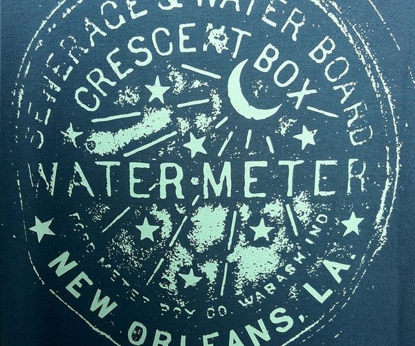 The Southern Marsh Water Meter Tee is the latest addition to our Great American Cities collection. The iconic, iron water meter cover in New Orleans, Louisiana, was invented, and has been continuously