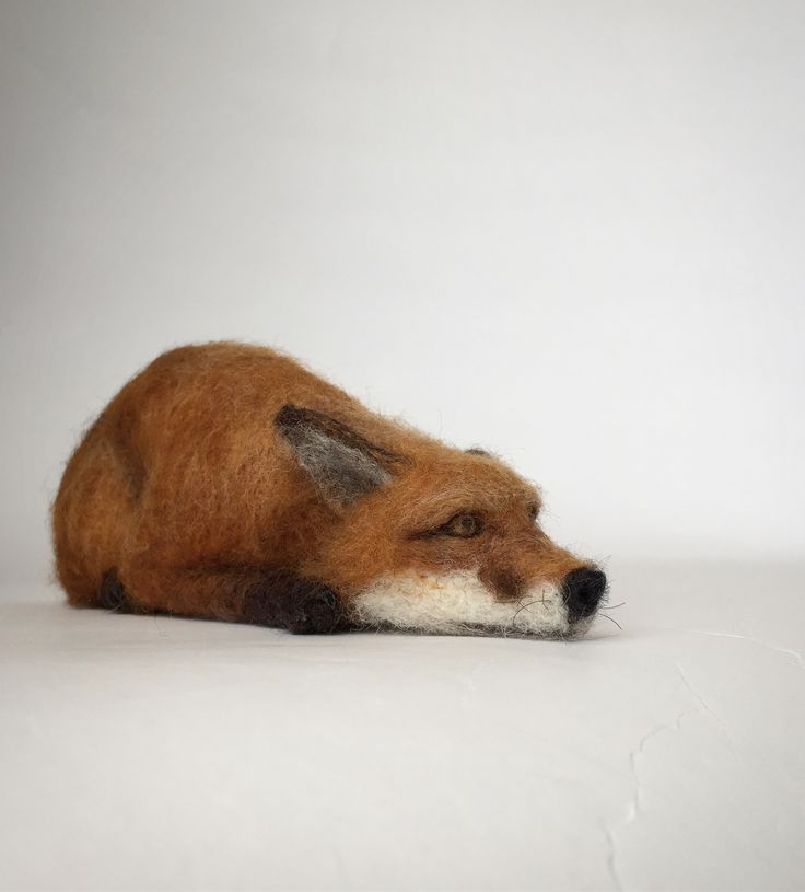 Needle felted fox sculpture.