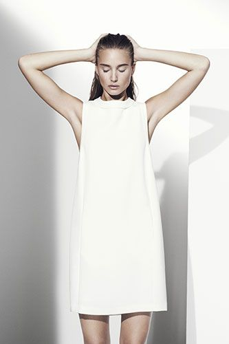 Marks & Spencer Spring Collection, high fashion, symmetrical modeling pose. white on white, studio photography
