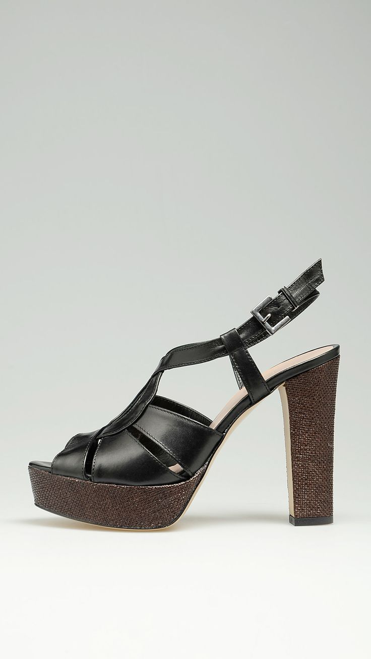 Leather crossover strap slingback sandals in black featuring a silver buckle closure, a dark chocolate raffia covered 1.2