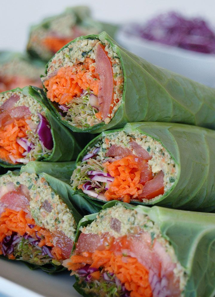 Falafel Burger Wrap in a Collard Green Leaf with carrot, sprouts, tomato, red cabbage and red onion.