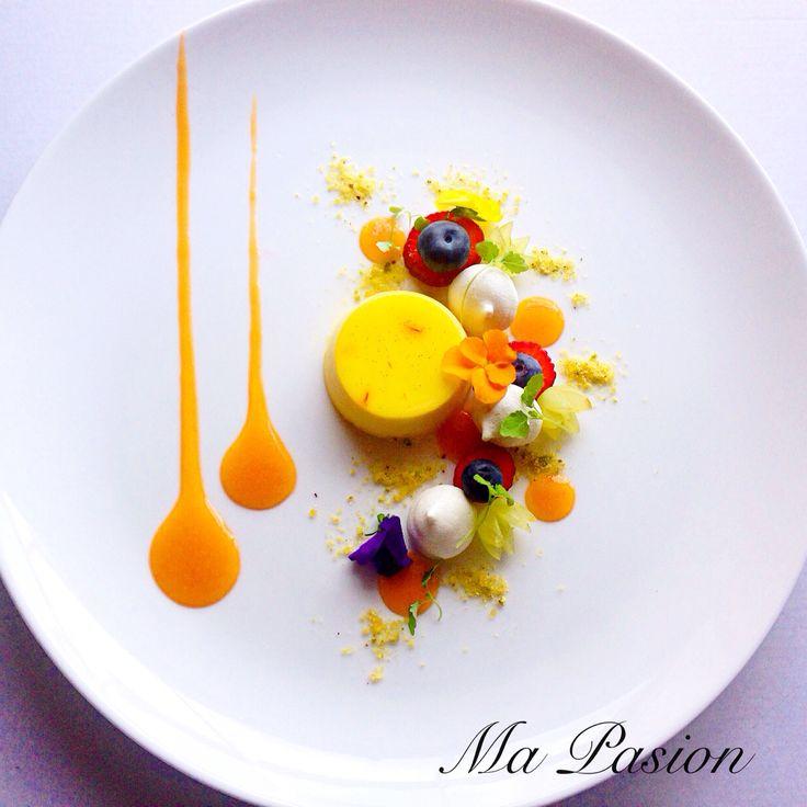 Saffron panna cotta with apricot purée, pistachio praline, meringues, berries
