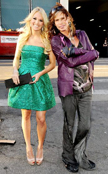 Carrie Underwood posing for pictures with Steven Tyler at the 46th Annual Academy of Country Music Awards in April 2011