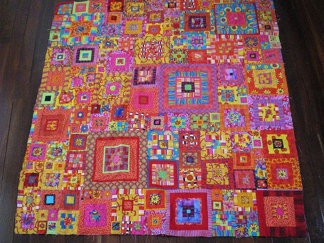 sunnysidey - My lovely Kaffe Fassett quilt top -  I made this over two years ago: you'd have thought that I would have quilted it by now! I used a couple of Kaffe fabrics; many are by Jan Mullen, whose fabrics I love -- they go very well in this style of quilt.