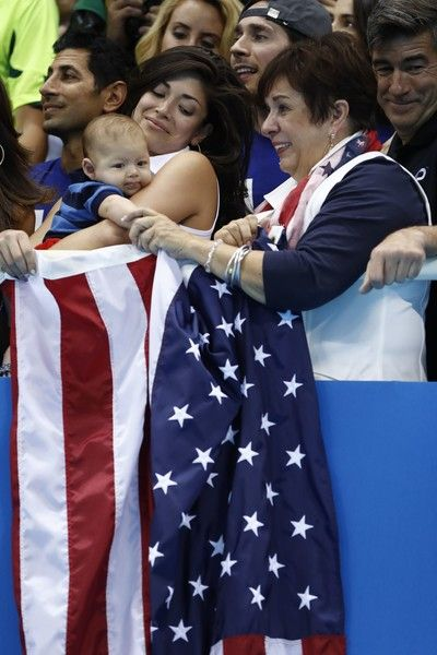 USA's Michael Phelps' mother Deborah (R) and partner Nicole Johnson (L) holding Michael Phelps' son, Boomer celebrate after the Men's swimming 4 x 100m Medley Relay Final at the Rio 2016 Olympic Games at the Olympic Aquatics Stadium in Rio de Janeiro on August 13, 2016.   / AFP / Odd ANDERSEN