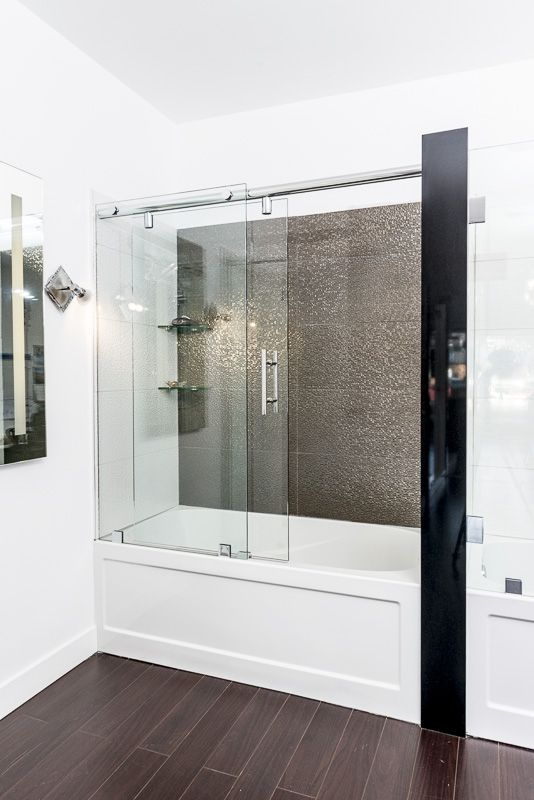 The boys bathroom bathtub glass enclosure