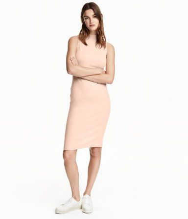 Sleeveless dress in cotton-blend jersey with mock turtleneck, slit at back, and deep armholes.
