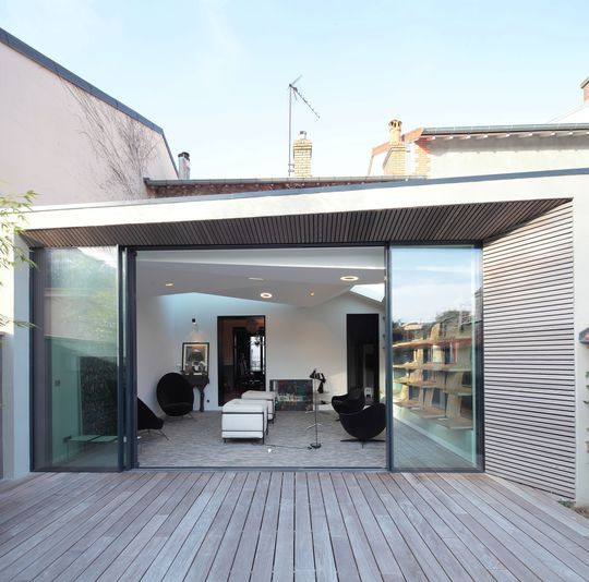 A simple, small, south facing extension at the rear of a - agrandissement maison bois prix m